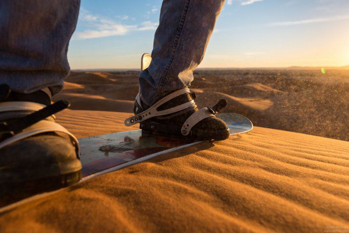 sandboarding in the gorges Chebbi dunes in Merzouga