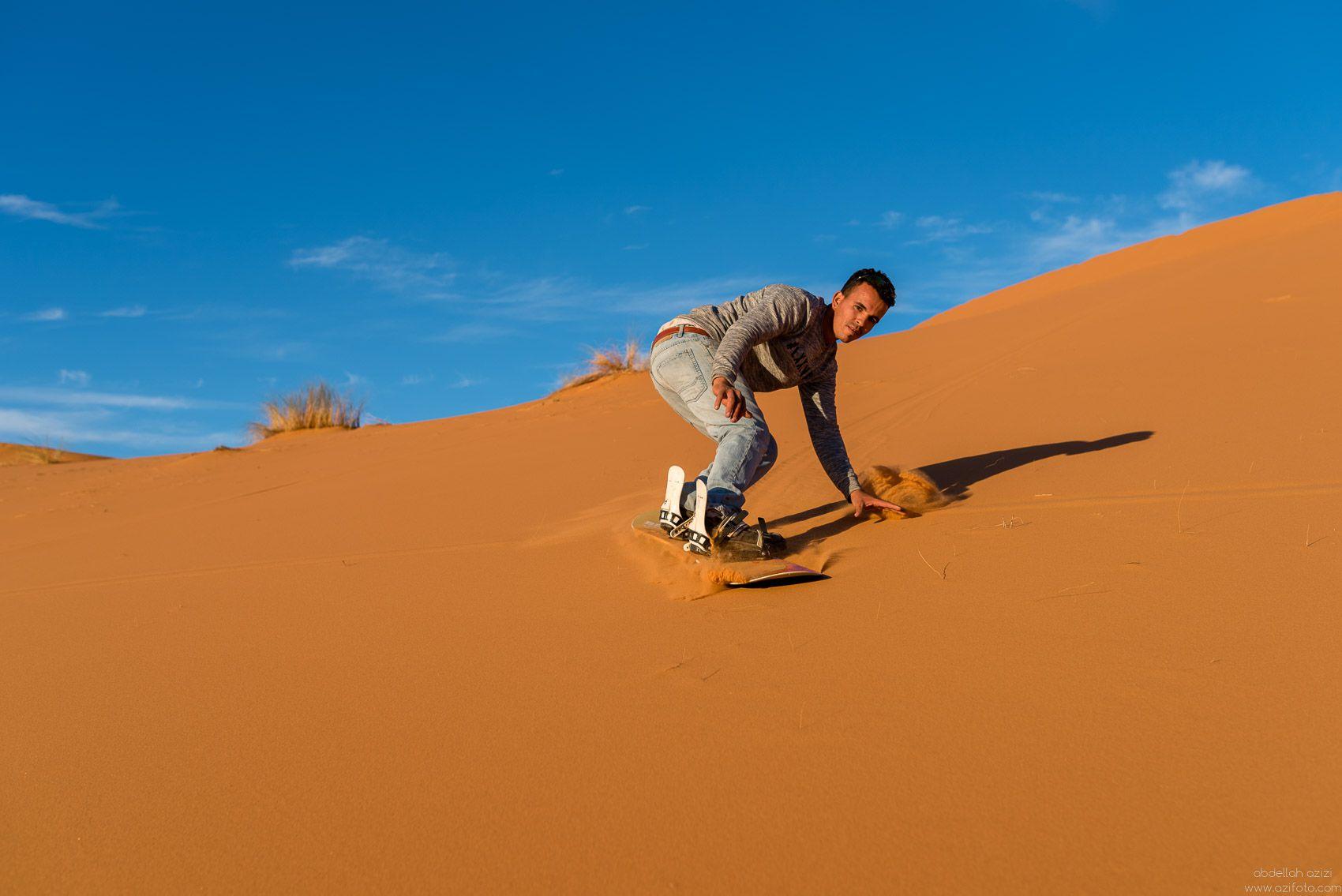 sand boarding in Morcco's desert