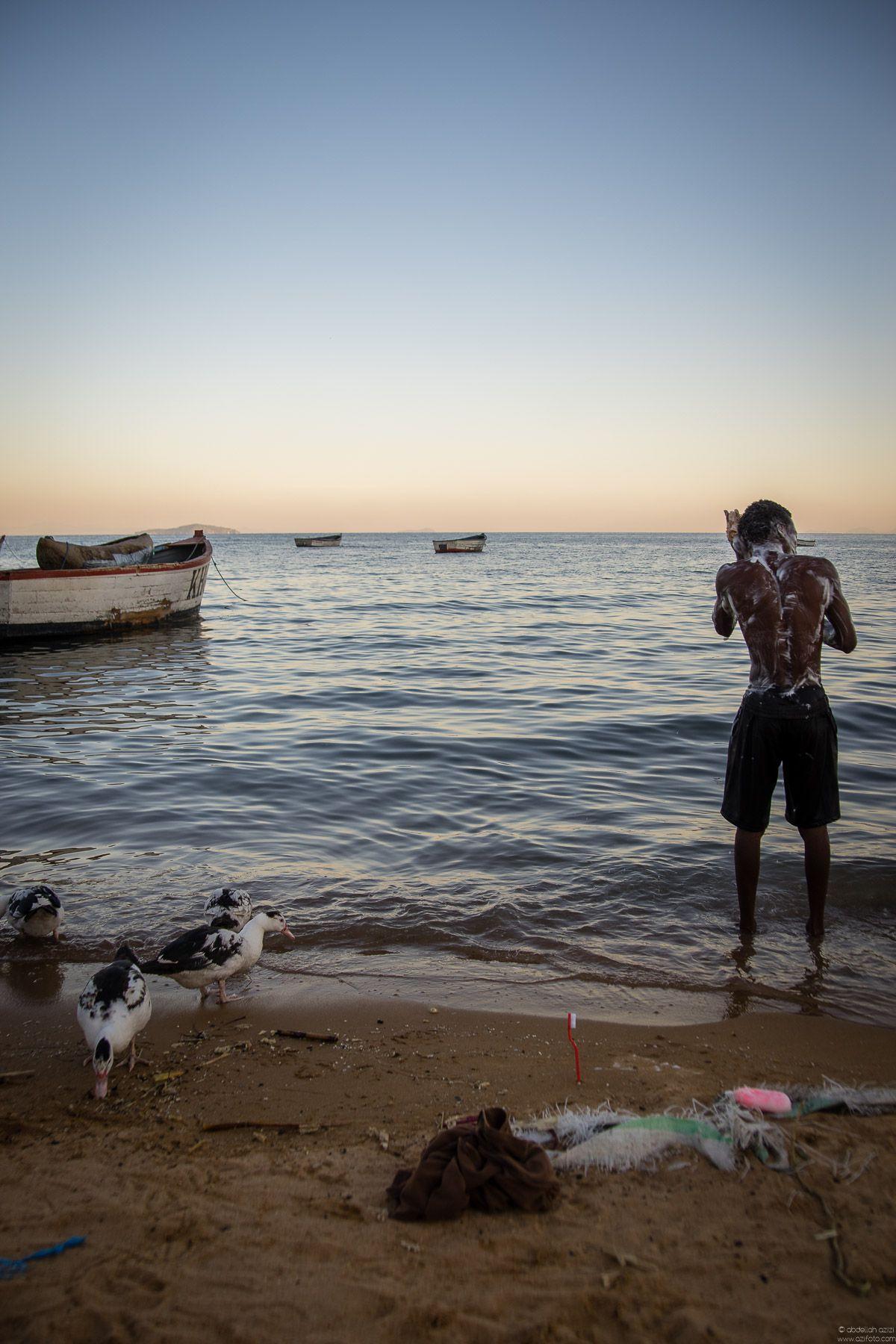 Boy having a bath in the beach of Lake Malawi