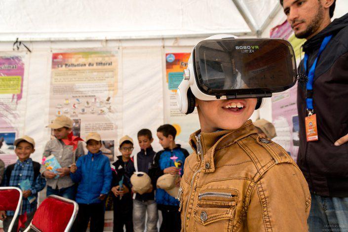 Boy trying VR, Morocco solar fetival