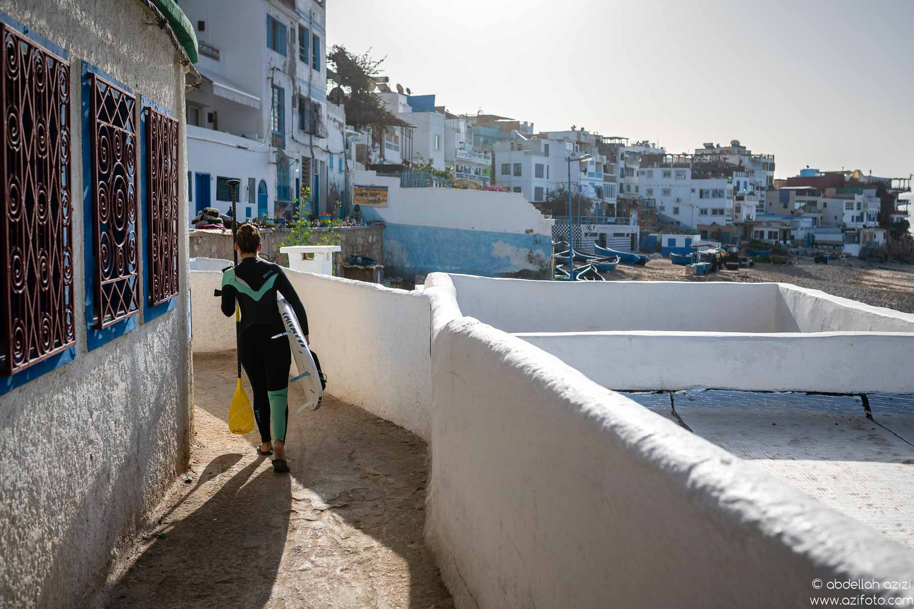 Surfer in Taghazout village, Morocco