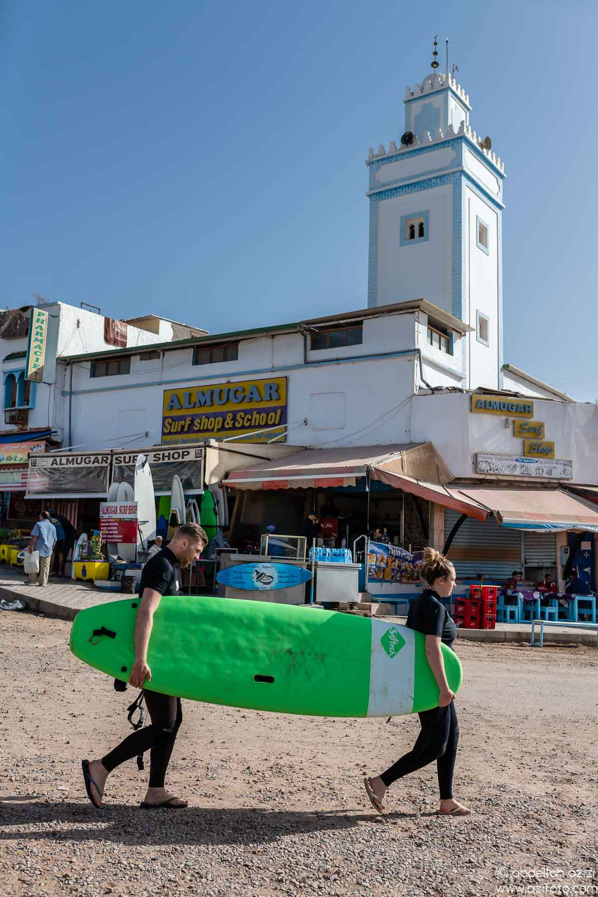 Sufer walking to taghazout beach