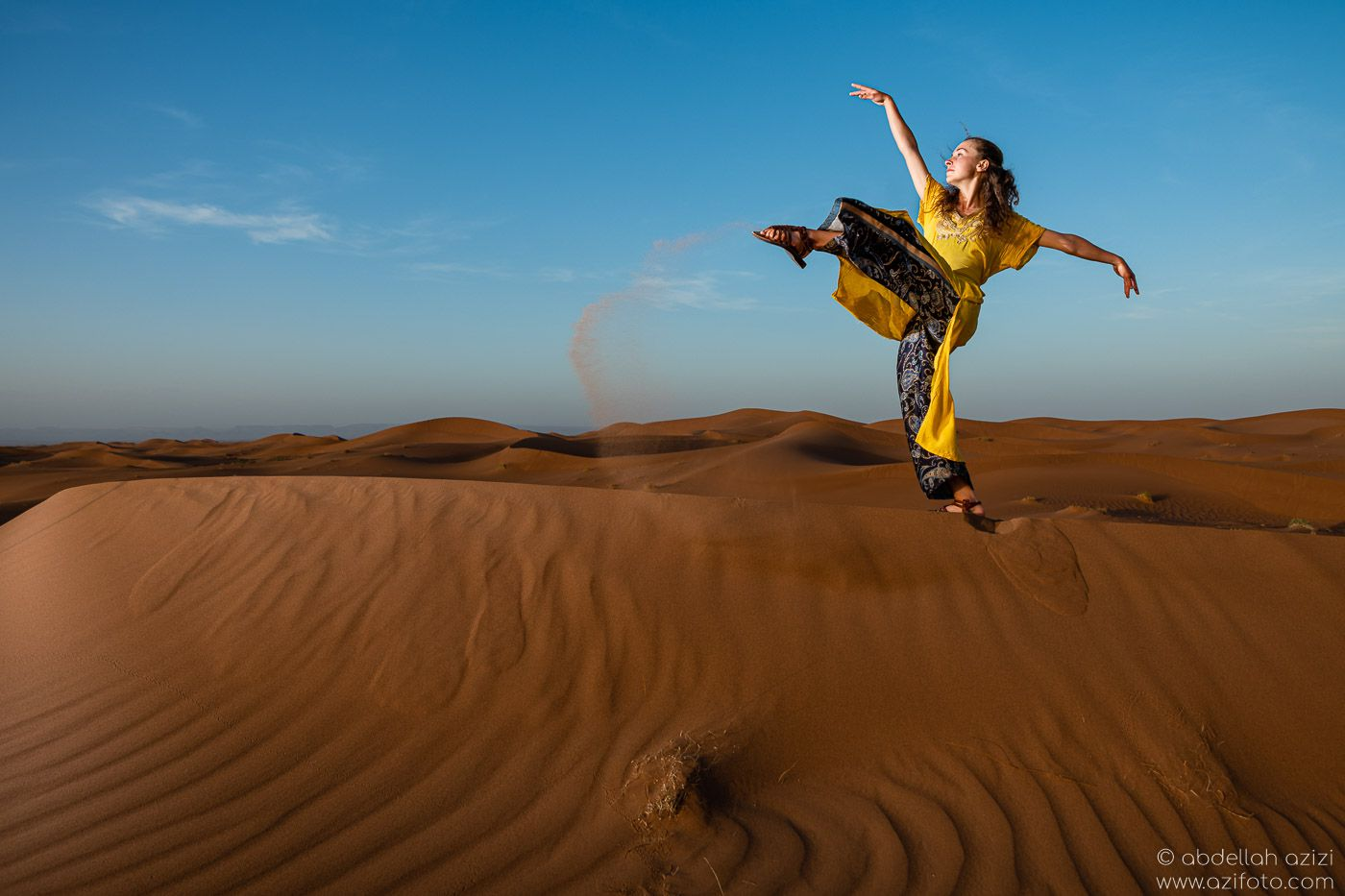 Desert dancer in sand sundes